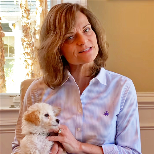 Dr. Bandlow sits holding her puppy