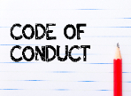 Code of Conduct printed on lined paper with a pencil laying on top of the paper
