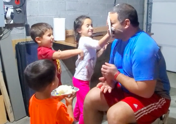 Coach Buzzetto's kids smash plates of mashed potatoes in his face