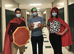 three students dressed as Math-A-Thon superheroes