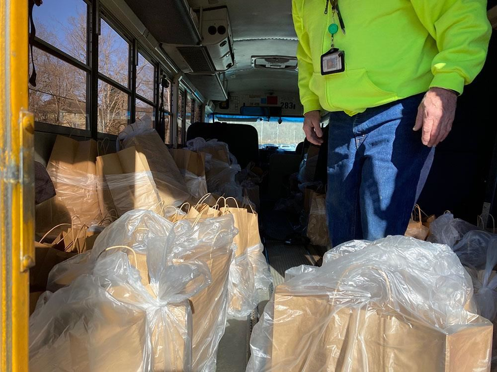 meal bags in the back of a bus, ready for distribution