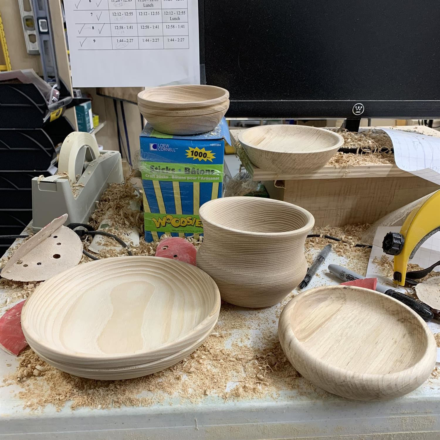 Mr. P's handmade bowls sit on his shop desk surrounded by saw dust